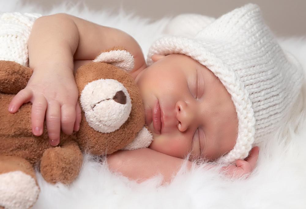 Newborn photographers need to be savy when posing the child