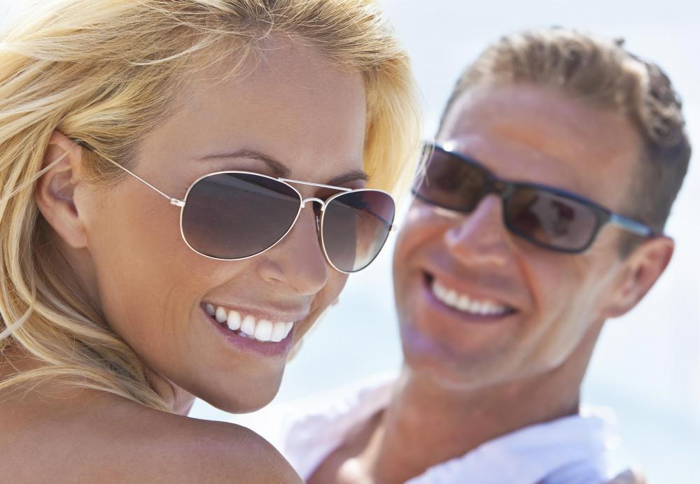Couple wearing sunglasses with polarized lenses.