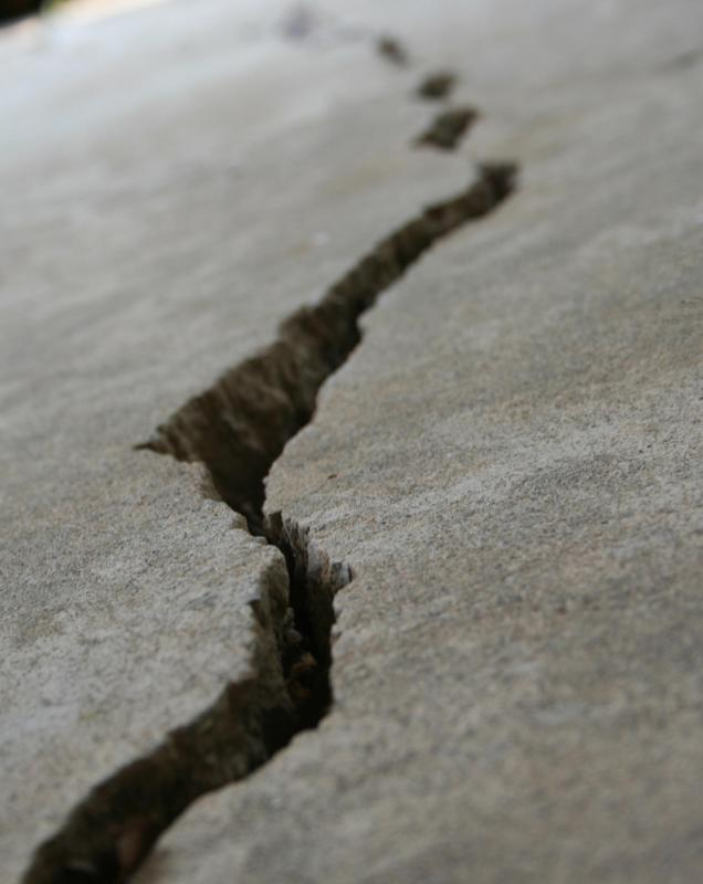 water may seep into an asphalt surface and cause the asphalt to crack