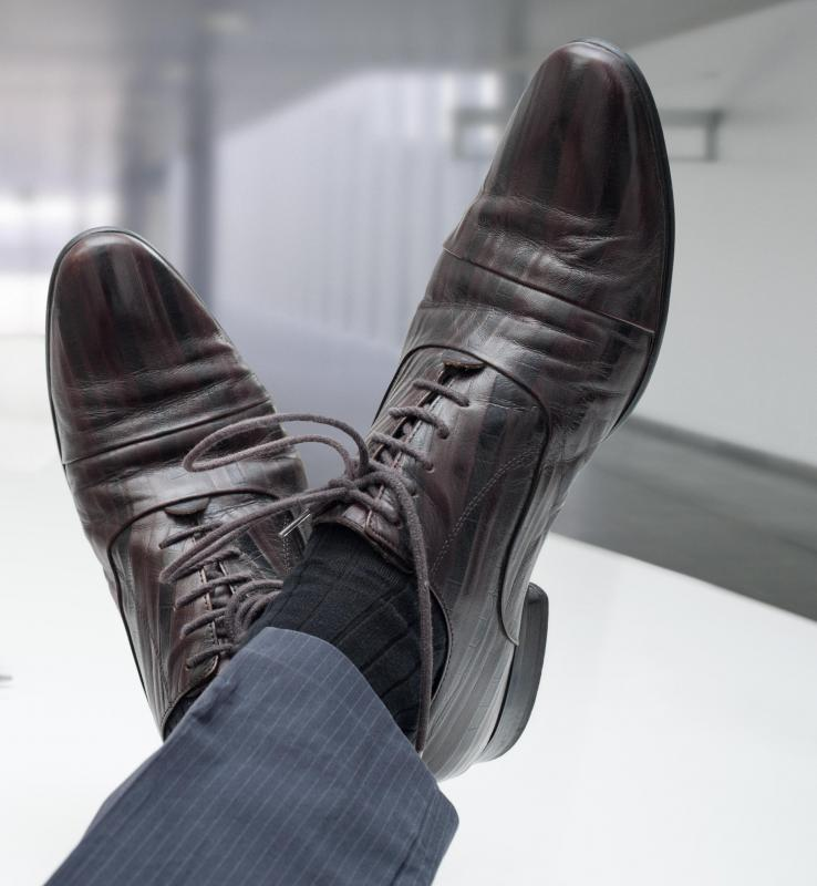 A tuxedo is typically worn with black socks and black shoes. - What Is A Tuxedo? (with Pictures)