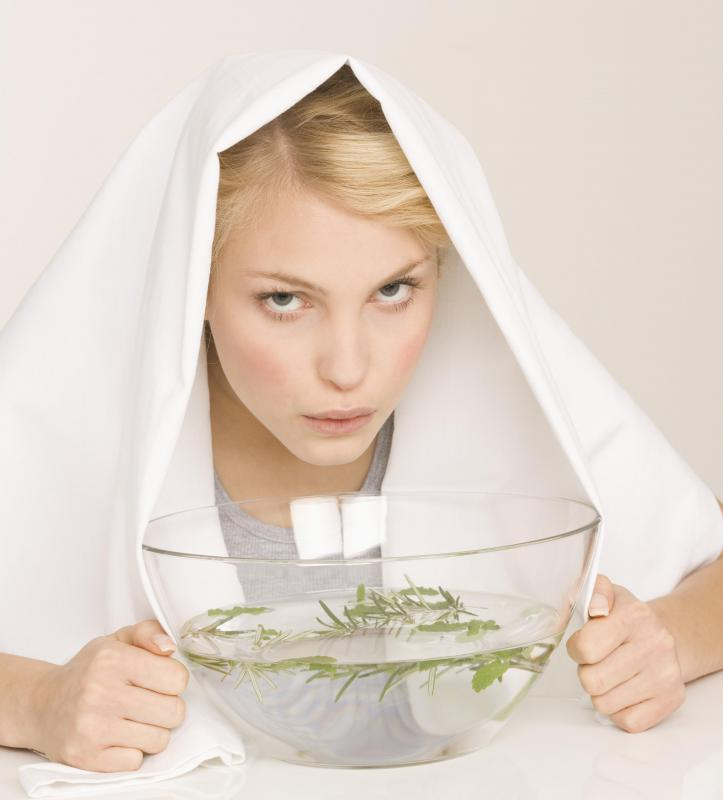 Inhaling steamed water with herbs will help ease laryngitis symptoms.