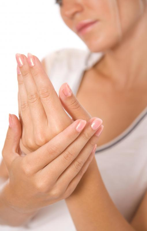 What are the symptoms of hand cramps?