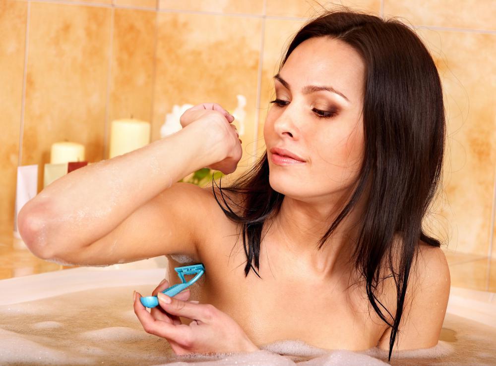 woman-shaving-her-underarms-with-razor.jpg