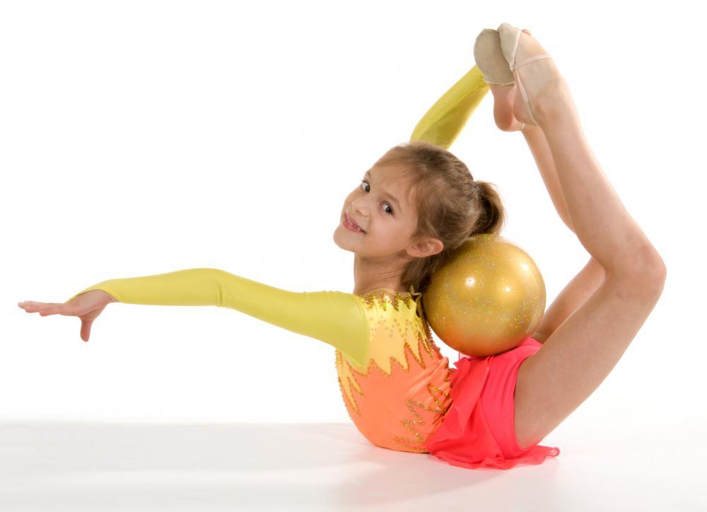 Young rhythmic gymnast with a ball.