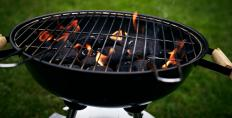 Beef kabobs being cooked on a charcoal grill should be basted with a little marinade as they cook.