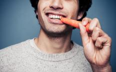 Eating carrots and other foods rich in carotene may cause people to have orange skin.