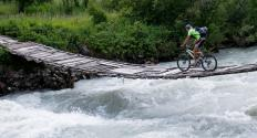 A person mountain biking.