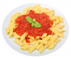 Corn penne is best served with a tomato-based sauce.