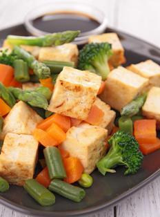 Tofu often replaces meat in a vegan stir-fry.